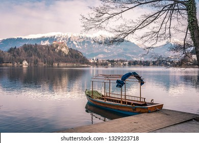 tourist boat on the lake Bled with the castle on the hill at the background