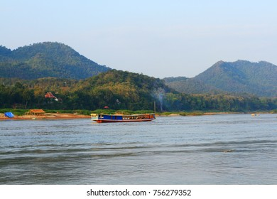 Tourist boat on the Mekong River in Luangprabang, Laos