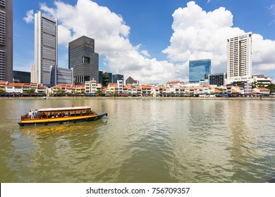 Tourist boat on the Singapore river along the Clark Quay on a sunny day in Singapore in Southeast Asia.