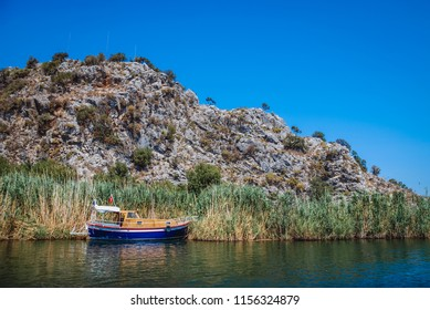 Tourist boat in River Dalyan bank between Dalyan village and Iztuzu Beach in Mugla Province of Turkey