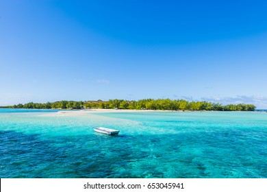 Tourist boat sailing along Gabriel and Flat tropical Islands off Mauritius Beach