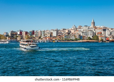 A tourist boat sails across the Golden Horn, Istanbul, Turkey