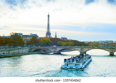 Tourist boat at Sienna river, Paris skyline with Eiffel tower in background, France