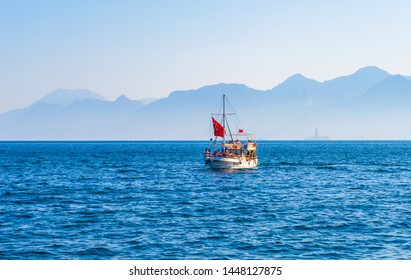 Tourist boat trip on the sea in Antalya, Turkey. Boat on the background of the mountains of Antalya