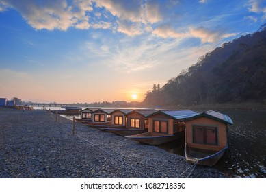 Tourist boats along the Katsura river at sunrise, Arashiyama district, Kyoto, Japan.