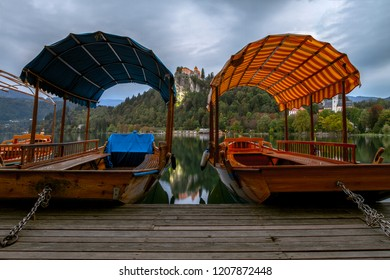 Tourist boats  on the on Lake Ble. Beautiful mountain lake Bledand and Medieval castle on the rock. Scenery at Bled lake in Slovenia. Mountains in background. Slovenia, Europe. European travel.