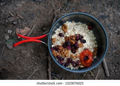 Tourist breakfast-oatmeal with dried fruits - cranberry, wallnut, apricot