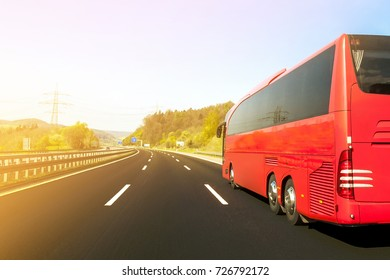Tourist bus on asphalt freeway road in beautiful spring day at countryside