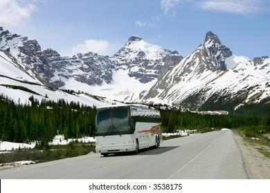Tourist bus on highway, Jasper National Park, Canada