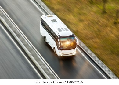 Tourist bus spee ride on highway, blured in motion