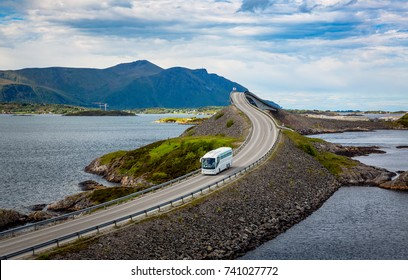 "Tourist bus traveling on the road in Norway. Atlantic Ocean Road or the Atlantic Road (Atlanterhavsveien) been awarded the title as ""Norwegian Construction of the Century""."