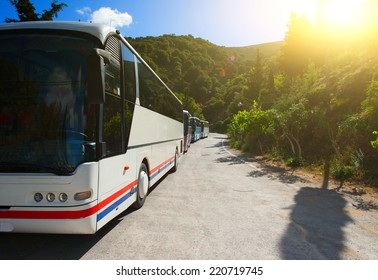 Tourist buses on a parking expect passengers