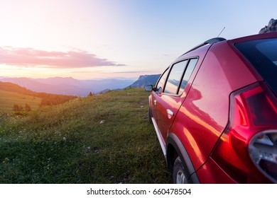 Tourist Car In The Mountain At The Sunset