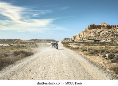 Tourist car and vintage dirt road