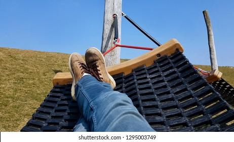 Tourist chilling in hammock, enjoying beautiful landscape, lazy free time
