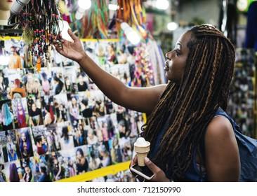 Tourist choosing handmade bracelet for souvenir