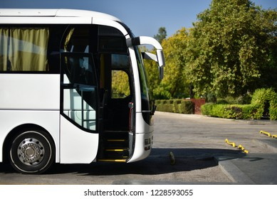 tourist coach with open door on bus station