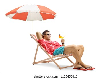 Tourist with a cocktail sitting in a deck chair with an umbrella isolated on white background