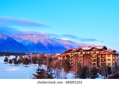 Tourist complex on the background of mountain scenery in ski resort Bansko, Bulgaria