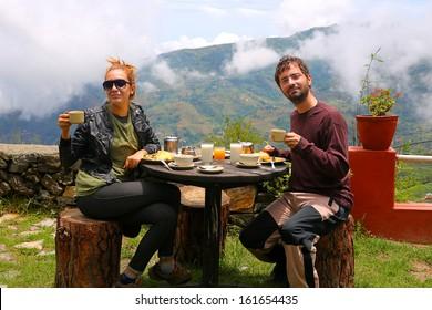 Tourist couple eating breakfast in himalayas mountains at Nagarkot, Kathmandu, Nepal