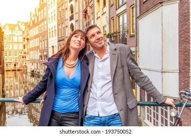 tourist couple exploring new city