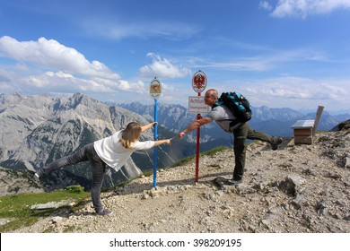 Tourist couple hiking at the beautiful mountains. Point of Austria and Germany