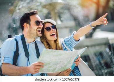 Tourist couple in love enjoying city sightseeing