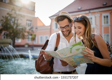 Tourist couple traveling. Travel. Walking on street. Portrait of beautiful young people