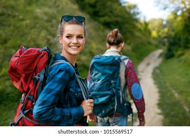 Tourist Couple Traveling, Walking In Nature. Portrait Of Beautiful Smiling Young People With Backpacks  Hiking In Mountains On Weekend In Summer. Couple Travel In Nature Concept. High Resolution.