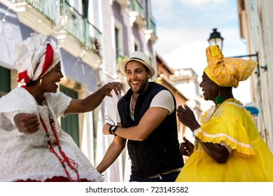 "Tourist dancing with local ""Baianas"" in Salvador, Bahia, Brazil"