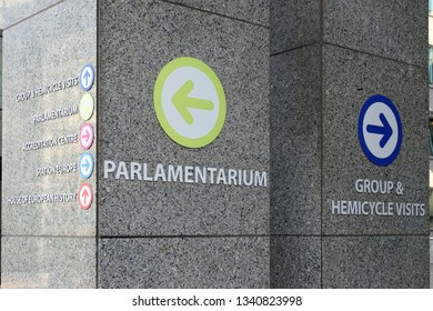 Tourist direction signs in the grounds of the European Parliament in Brussels, Belgium.
