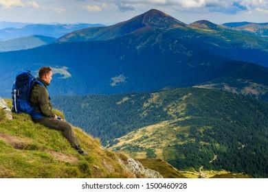 Tourist enjoy the beautiful foggy landscape of Goverla Mountain - highest mountain of the Carpathians. Hoverla from Mount Petros. Near the village of Lazeshchyna, Ukraine - September 7, 2019
