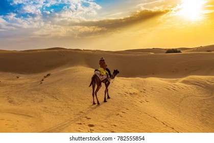 Tourist enjoy desert safari camel ride at Thar desert Jaisalmer, Rajasthan, India.