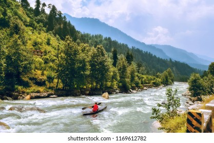 Tourist enjoy river rafting on Beas river with scenic landscape at Manali Himachal Pradesh, India.