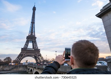 Tourist enjoy view on Eiffel Tower from street. Winter in Paris, France