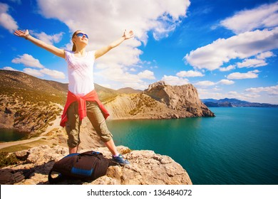 tourist is enjoying landscape with outstretched arms