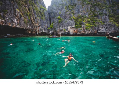 Tourist enjoying snorkeling activity near island in krabi
