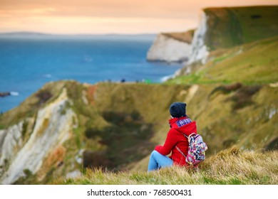 Tourist enjoying view of Man O'War Cove on the Dorset coast in southern England, between the headlands of Durdle Door to the west and Man O War Head to the east, Dorset, England.