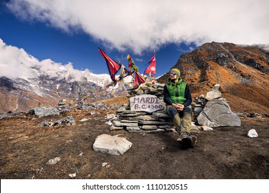 Tourist with enjoying the view of snowy Himalayan Mountain at Mardi Himal Base Camp in Nepal