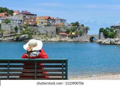A tourist enjoys amazing view of Historical Amasra - Amasra town, Bartin - Turkey