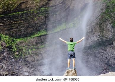 Tourist enjoys the Gocta waterfall in nothern peru Gocta Waterfall/ Chachapoyas/ Peru/ south america