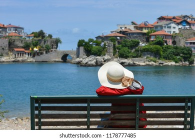 A tourist enjoys the view in Amasra - Amasra is a small sea resort town in Bartin - Blacksea region / Turkey