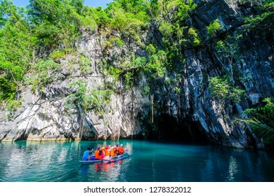 Tourist entering on a little rowing boat, Unesco World Heritage Site, Puerto Princessa underground river, Palawan, Philippines