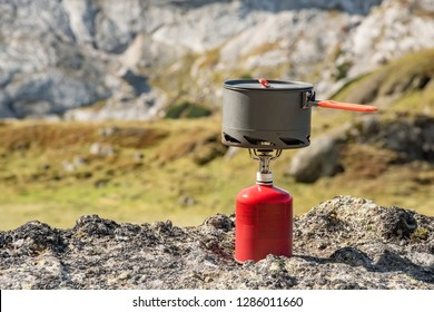 Tourist equipment and tools: camping gas over Marmolada mountain background Dolomites Italy