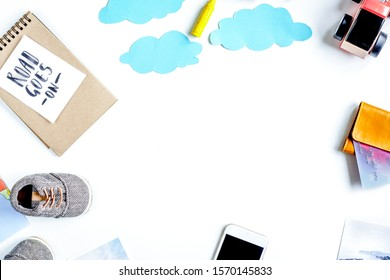 tourist equipment with toys and notebook for traveling with kids on white background top view mock up