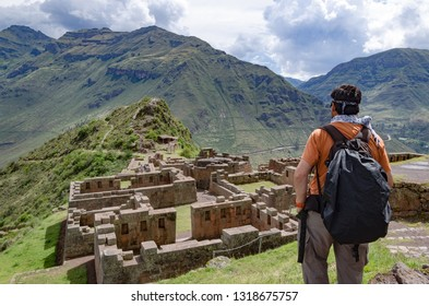 Tourist exploring the Inca Trails leading to the ruins of Pisac, Sacred Valley, major travel destination in Cusco region, Peru. Vacations and adventures in South America.
