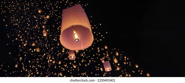 Tourist floating sky lanterns in Loy Krathong festival , Chiang Mai ,Thailand.