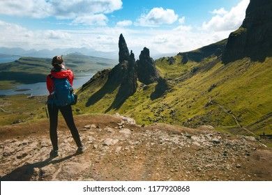 Tourist friends on a top of mountains in a Scottish Highlands. Scotland nature. Tourist people enjoy a moment in a nature.  Tourists favourites place in Scotland - Isle of Skye.