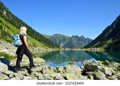 Tourist at Gaube lake. Hautes Pyrenees, France.