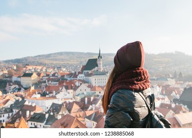 Tourist girl admires beautiful view of the city landscape in Cesky Krumlov in the Czech Republic.